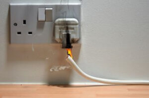 electrical plug socket wire on fire